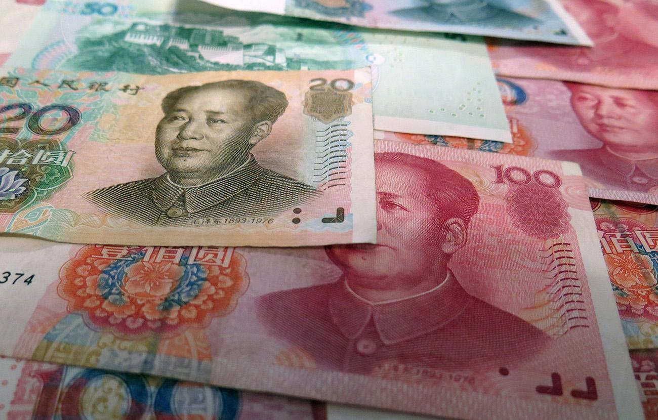 Las autoridades chinas detienen a 21 personas acusadas de estafar a casi un millón de inversores
